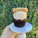 Chocolate Churro: Chocolate cupcake topped with cinnamon buttercream and a caramel churro.   Dozen: $48/dz